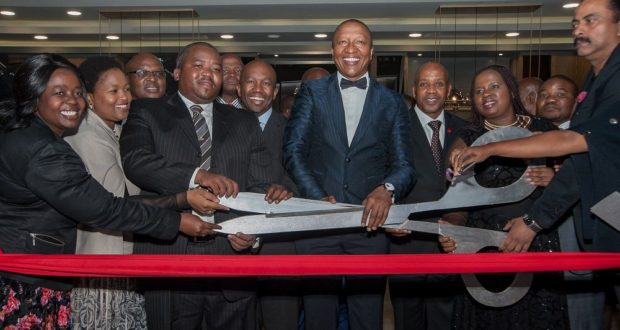 Billion Group CEO Sisa Ngebulana (centre) flanked by SA Tourism CEO Sisa Ntshona (first person immediately to the left) and Eastern Cape Premier Phumulo Masualle opening Mayfair Hotel